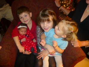 Elliot holding lil' sis Quincy, Ava holding lil' cousin Gemma